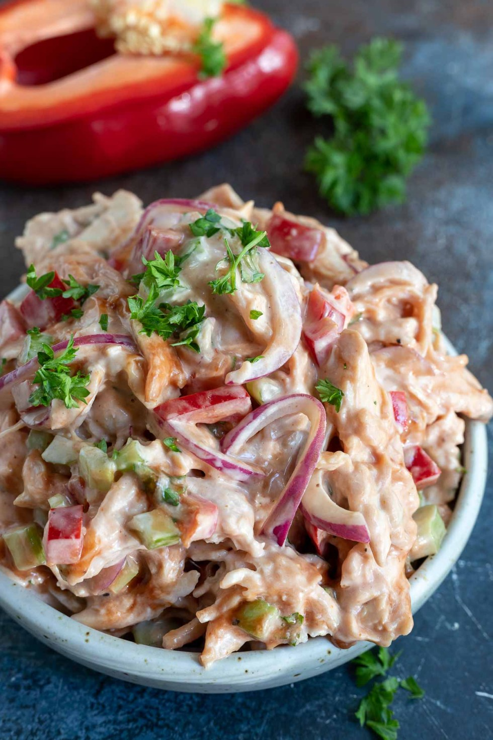 barbecue chicken salad in white bowl