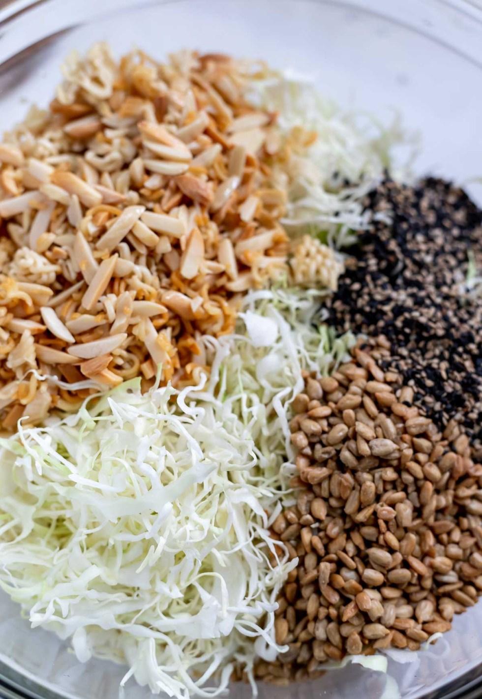ramen coleslaw ingredients in clear glass bowl