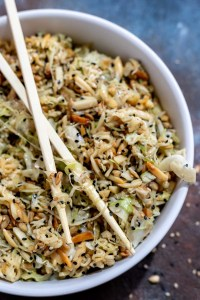 ramen coleslaw in white bowl with wooden chopsticks on top