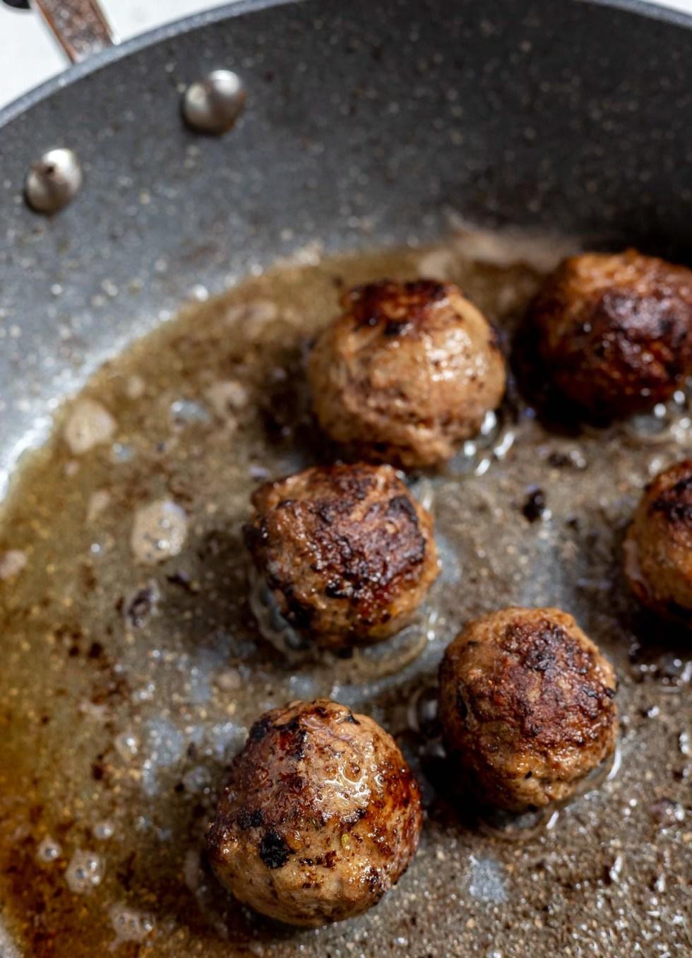 browned meatballs in fry pan