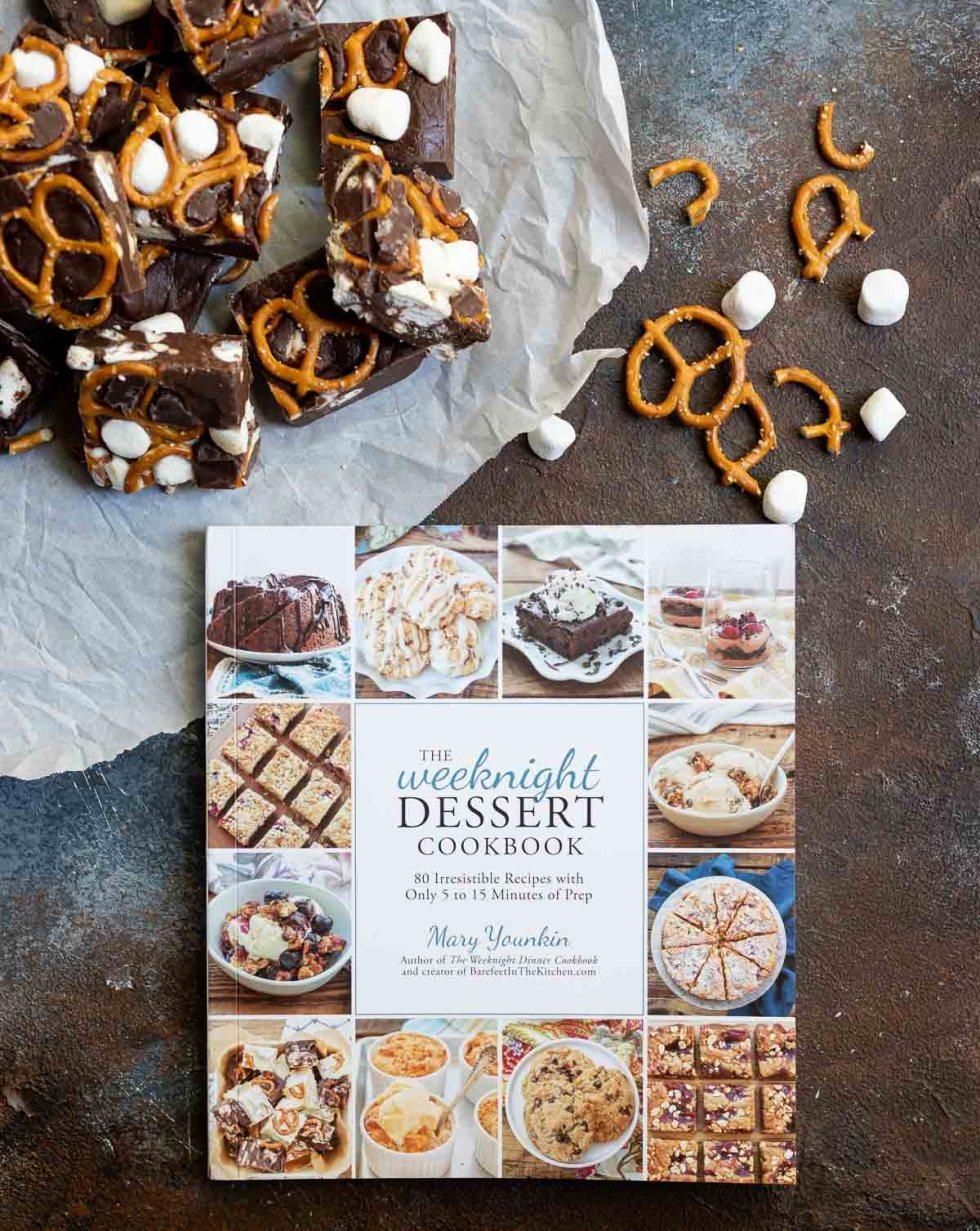 dessert cookbook next to fudge squares