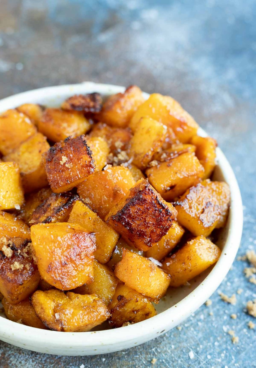 roasted butternut squash chunks in white serving bowl
