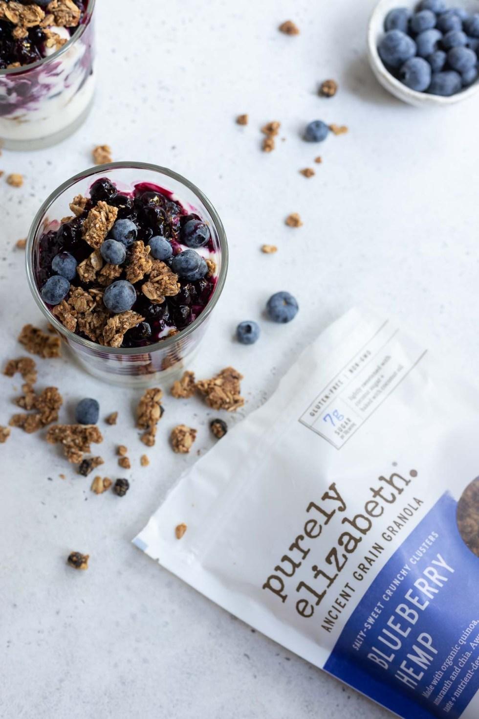 granola blueberry yogurt parfait next to bag of granola