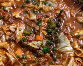 cabbage soup filled with vegetables and topped with thyme