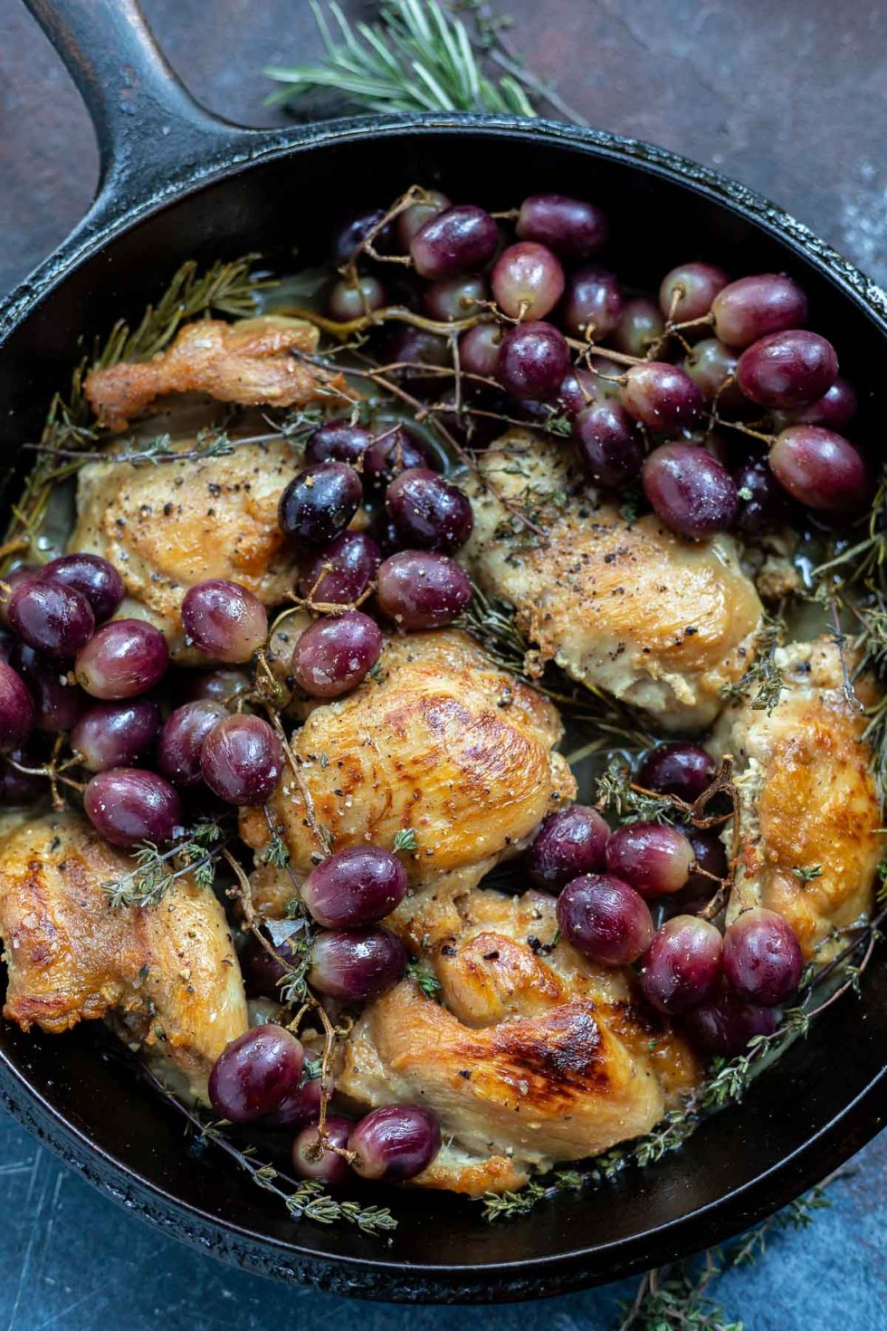 chicken grapes and herbs in cast iron pan