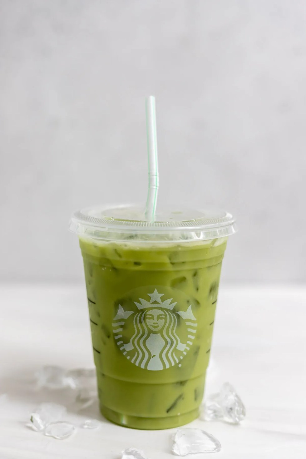 single plastic cup filled with matcha drink