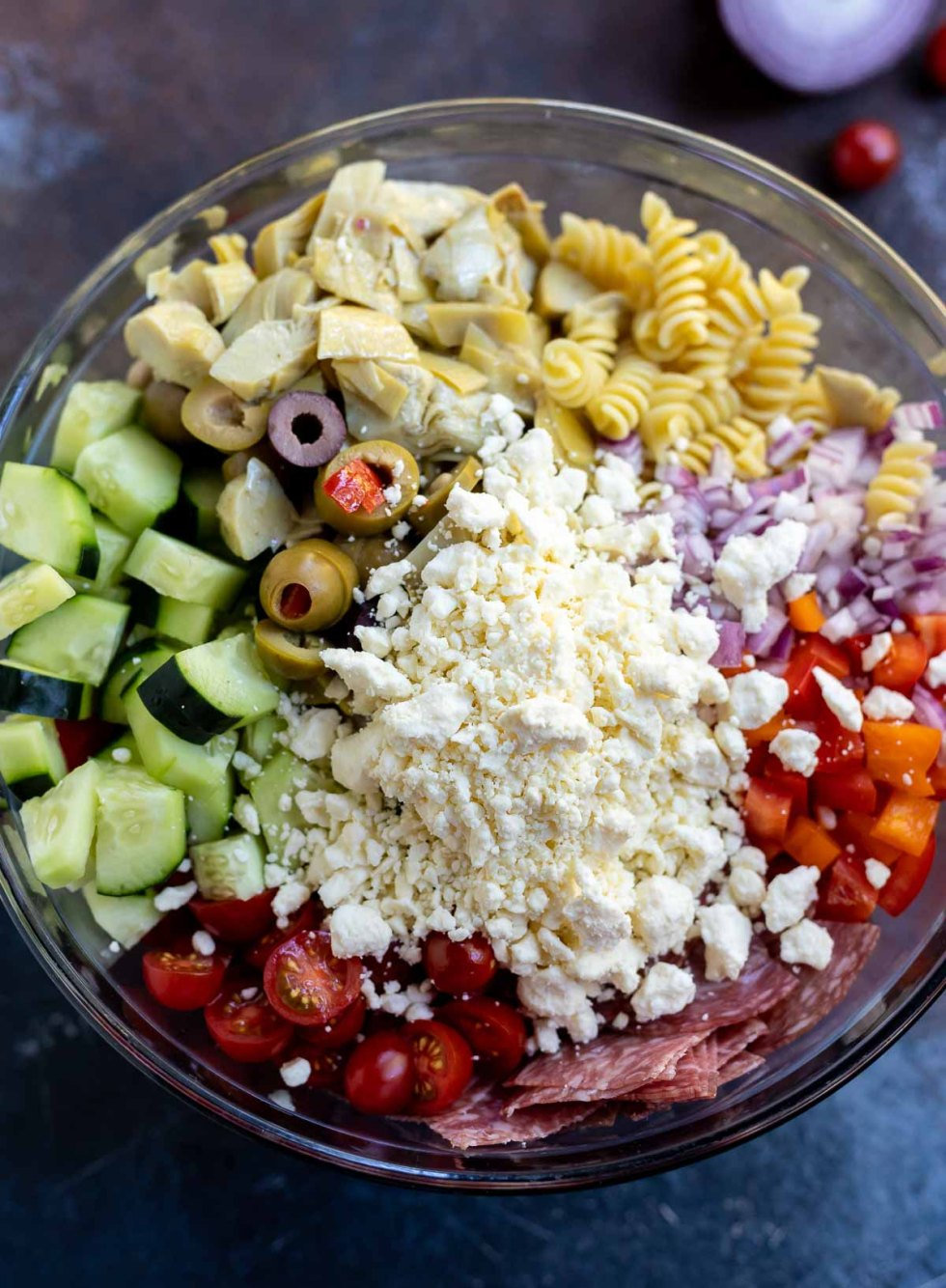 pasta salad ingredients in clear bowl