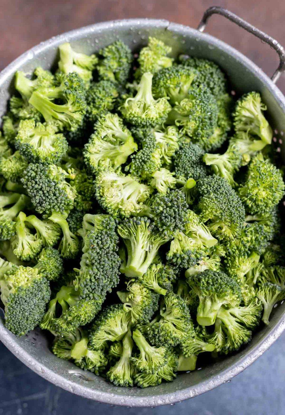fresh raw broccoli in colander