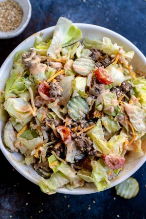 prepared salad and dressing in bowls