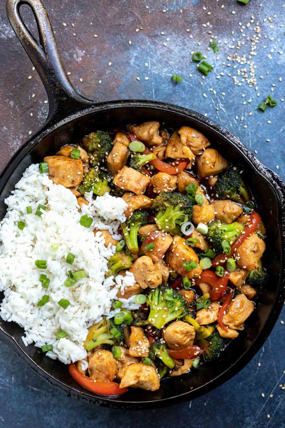 black cast iron pan filled with teriyaki chicken and rice