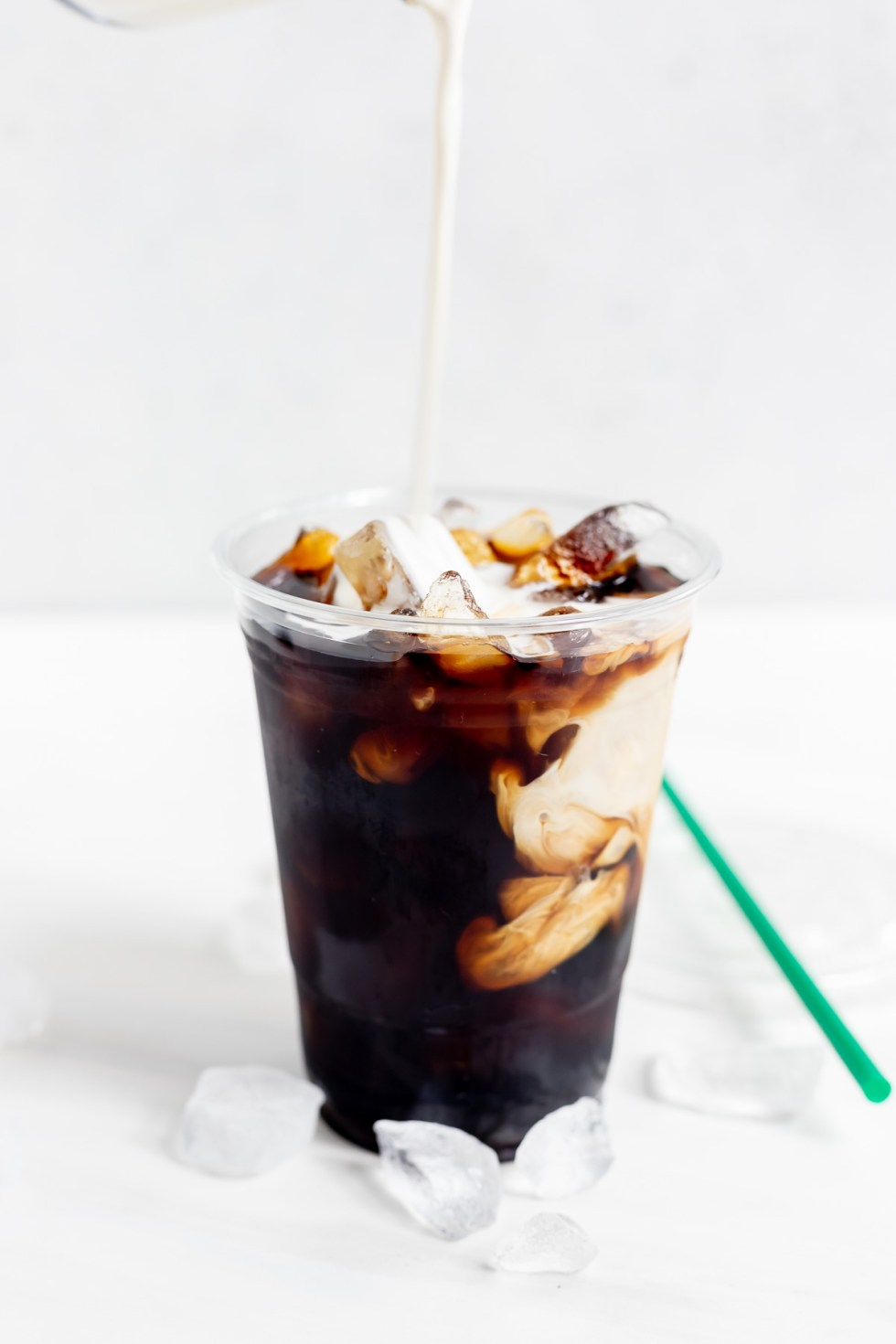 coffee cream and ice in clear cup