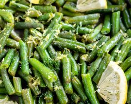 green beans and lemon wedges in pan