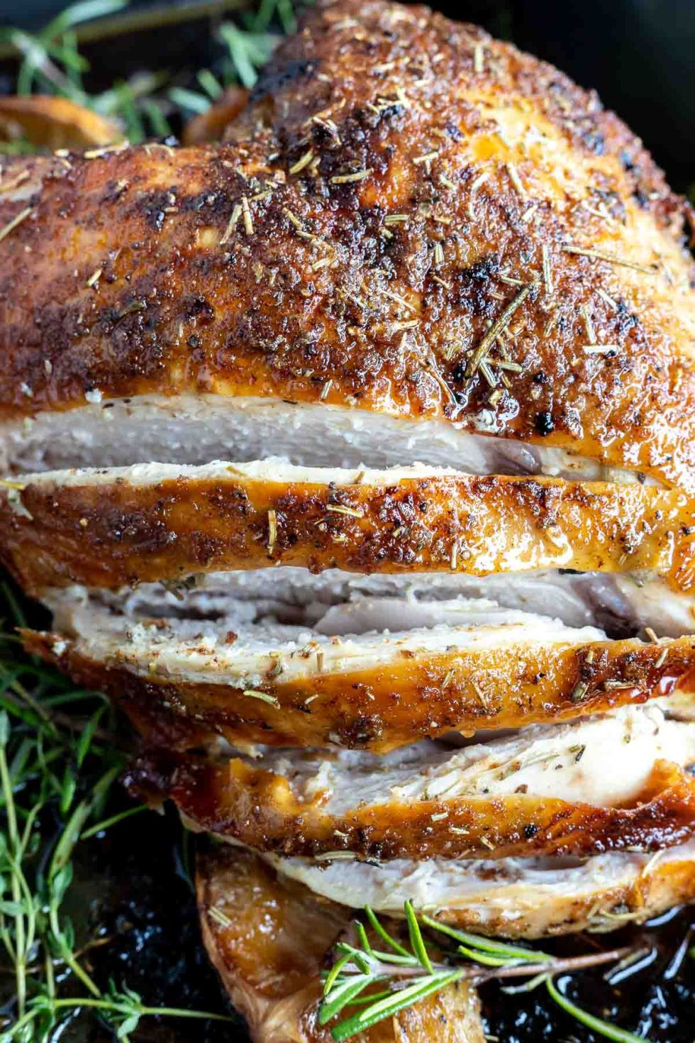cooked turkey breast sliced showing the white meat inside