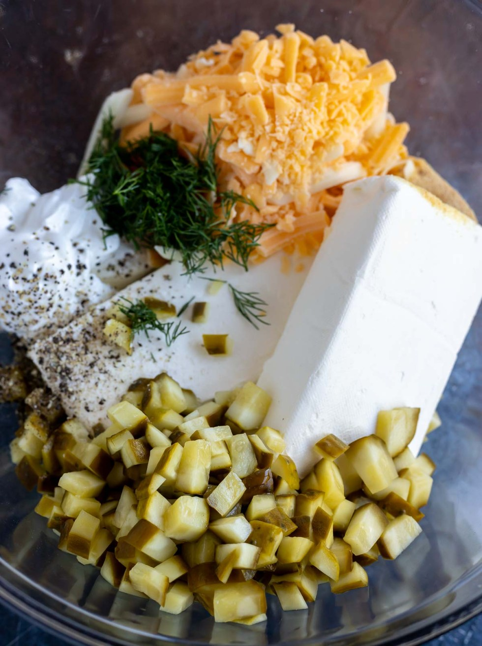 cheese ball ingredients in clear glass bowl