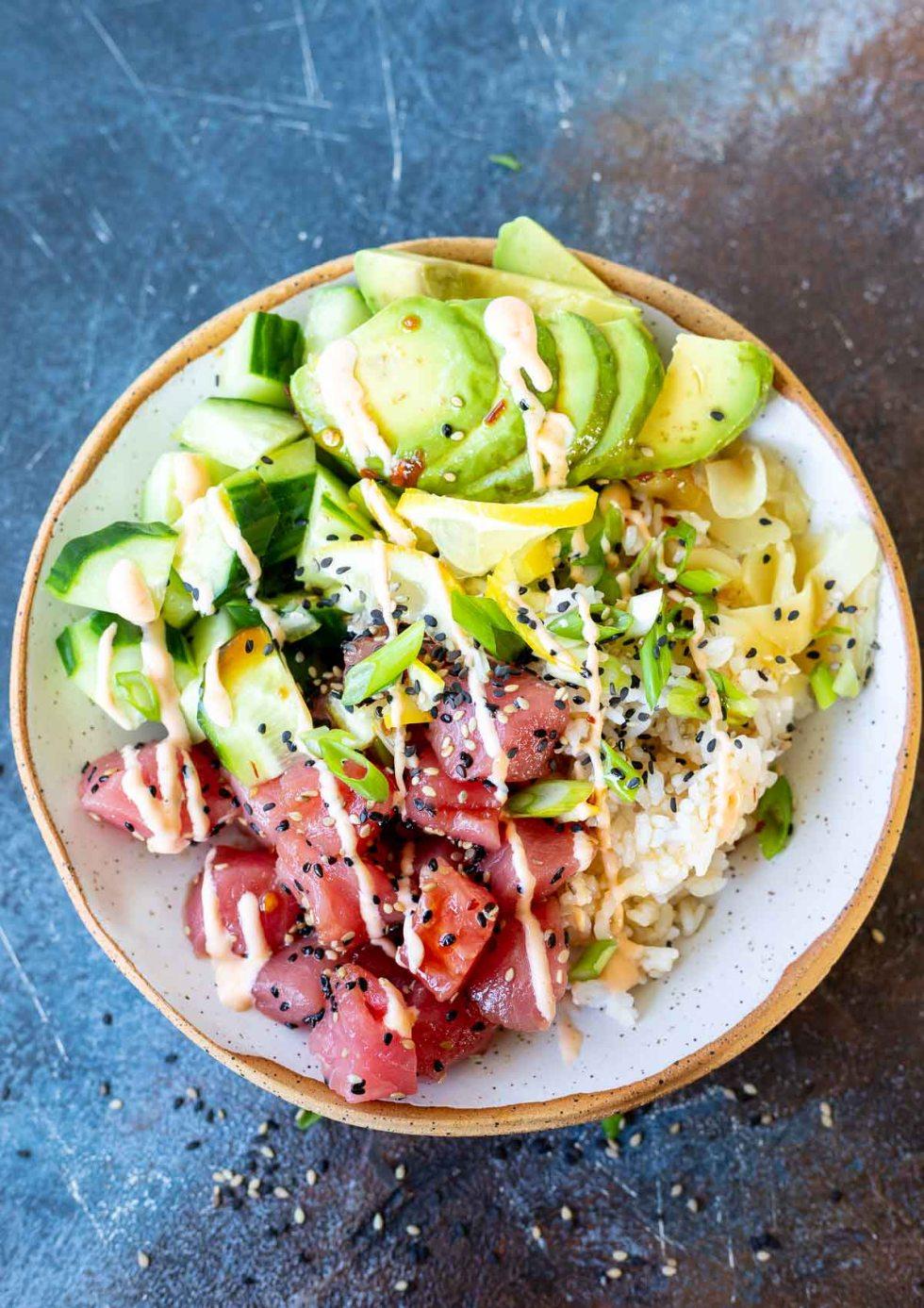 prepared tuna poke served in white speckled bowl