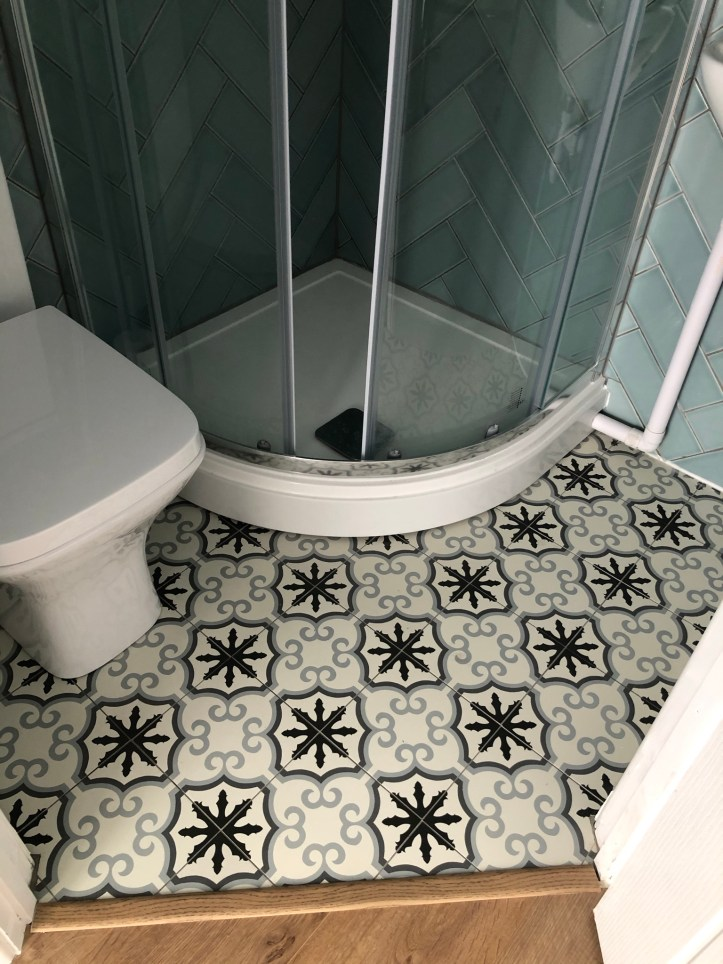 patterned tile floor tiny ensuite bathroom