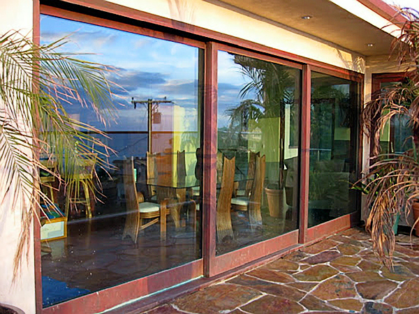 Koa wood and copper clad lift and slide doors  Wood Art Design