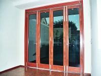 Teak veneer kitchen vanities and rosewood pivot door ...