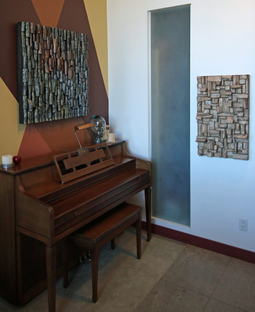 Contemporary wood wall art makes a big statement and creates unique visual impact in the room and improves sound quality at the same time.