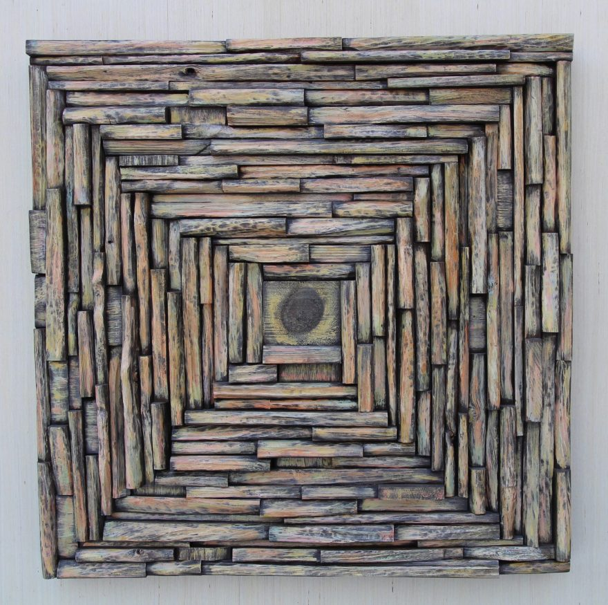 Wood collage sculpture, stunning wall assemblage interplays with illusion, surface and depth.