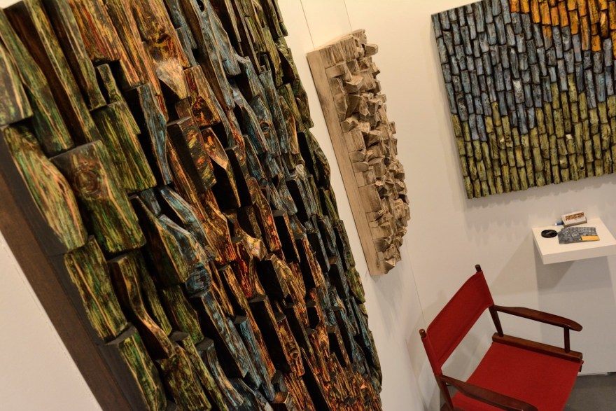 Highly distinctive wood wall sculptures by canadian artist Olga Oreshyna, with a richly textured surfaces and intricate wood blocks shapes on display at Artist Project Toronto Contemporary Art Fair