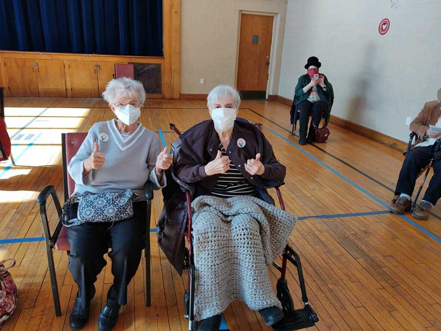 Sisters Dottie Malerba and Ann Adamovich give their thumbs up after receiving the COVID vaccine hosted by Woodbridge Human Services at The Woodbridge Center.