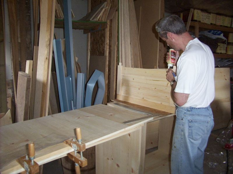 Inserting the T&G pine boards.