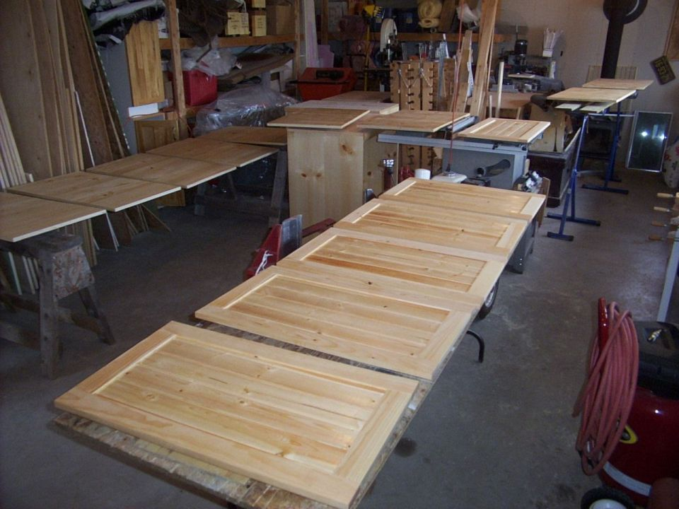 Solid pine frame and panel cabinet doors.