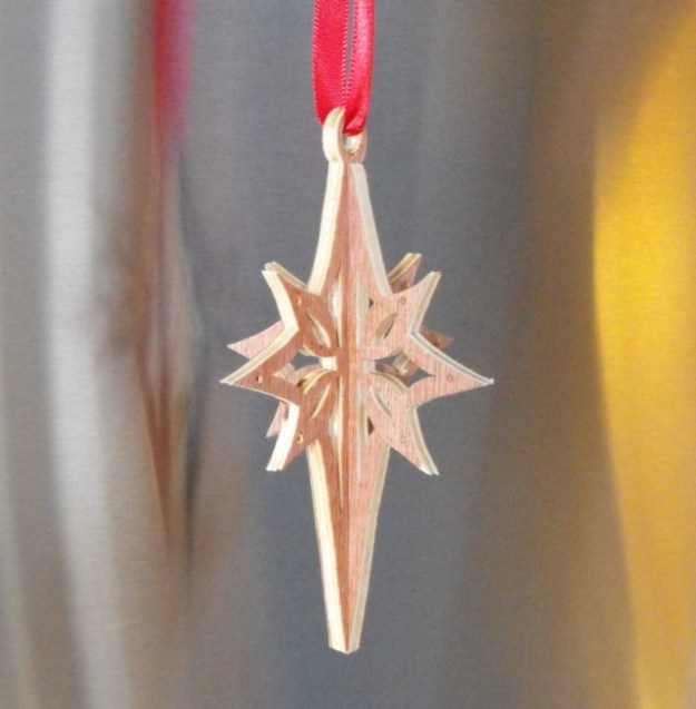 8. Finished scrollsawn Christmas ornament.
