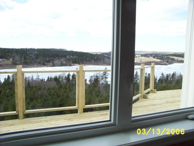 Deck railing with glass panels.