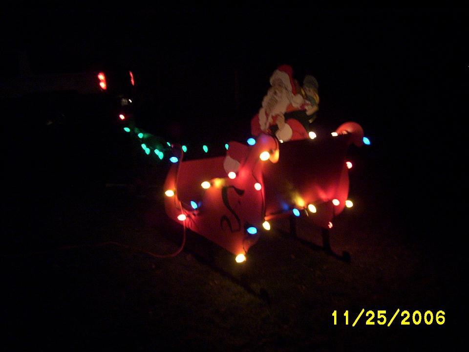Santa sleigh and reindeer yard art