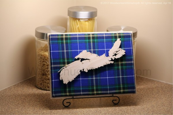 Wood map of Newfoundland with tartan background, woodworking,scrollsawing