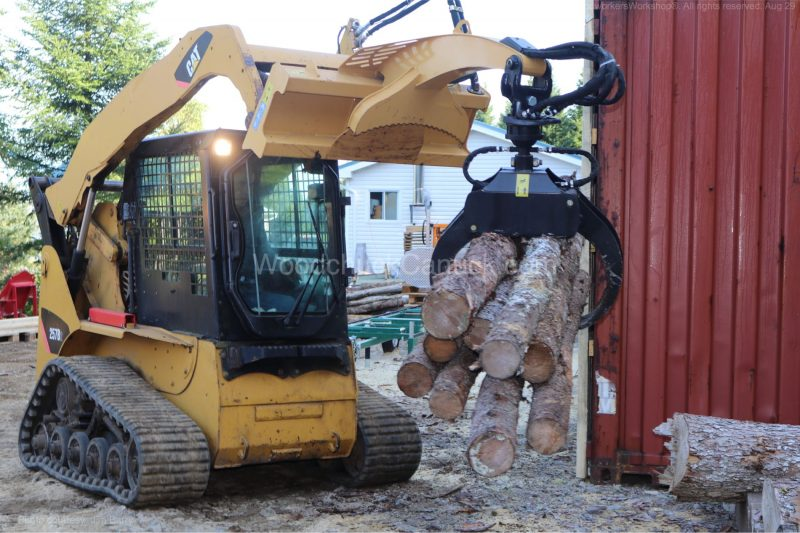 skid steer,grapple, logs,forestry
