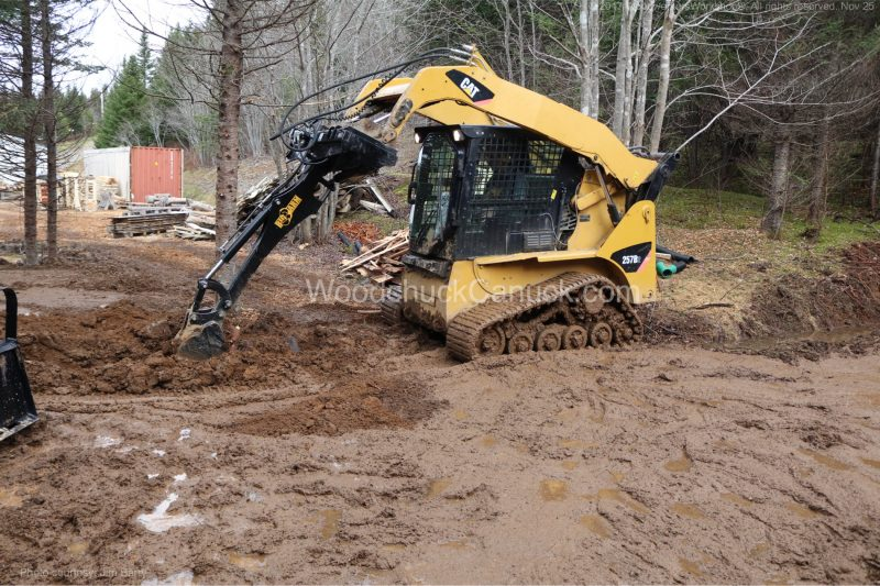 skidsteer,mud,clearing land