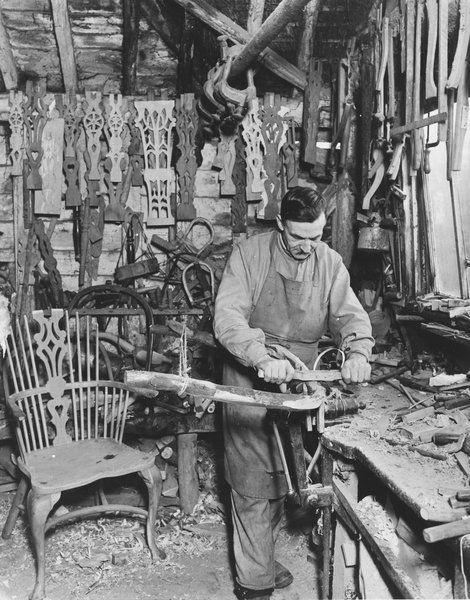 Carpenter making windsor style chairs