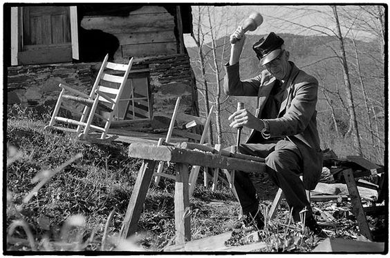 Pioneer carpenter making chairs.