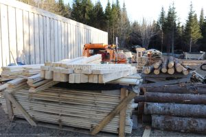 Stack of spruce 2x4 rough lumber