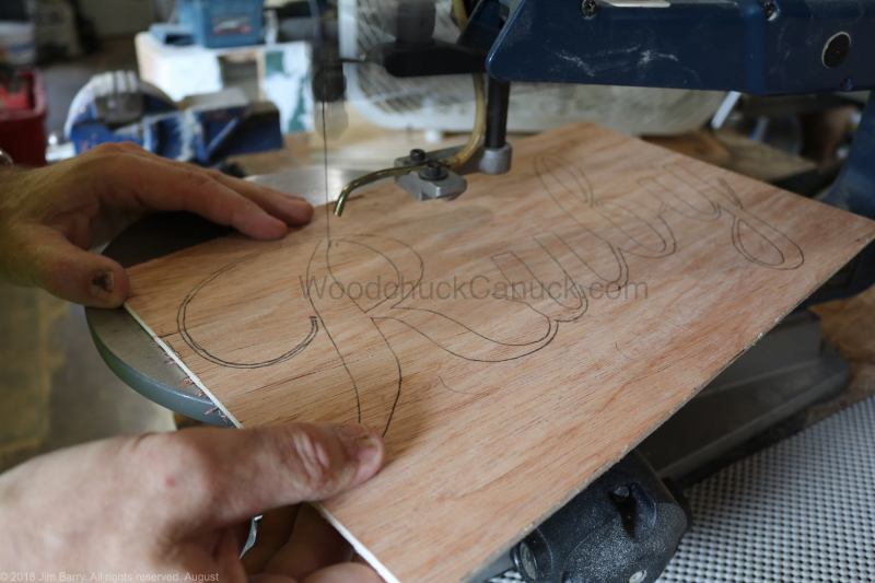 Cutting out a name sign on the scroll saw.