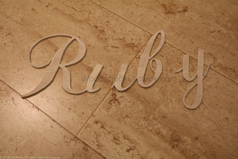 Ruby name sing cut from wood.