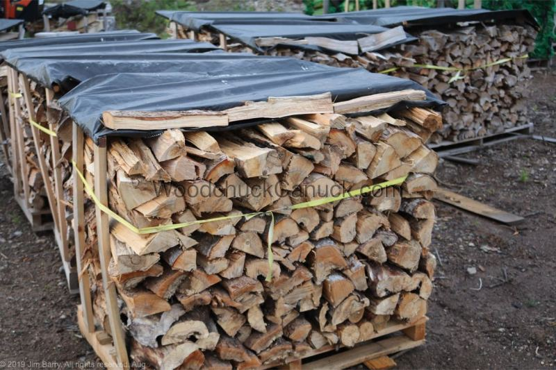 Split, dry firewood for campgrounds.