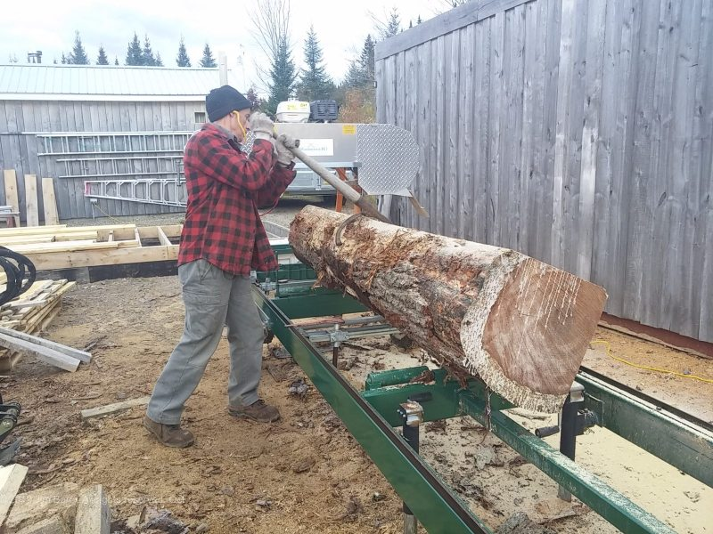 Custom cutting a pine log with the saw mill.