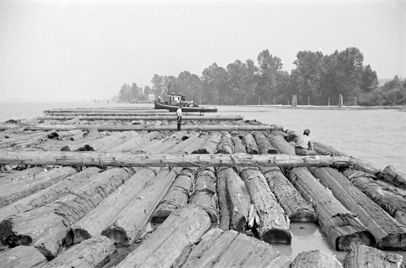 """1938 Tugboat """"Hyak"""" and log boom."""