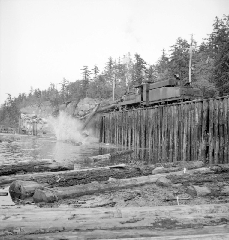1940-1948 Trains pushing logs into the water.