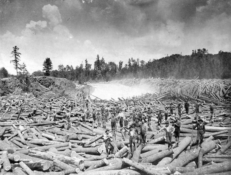 Log drivers sorting a large log jam.