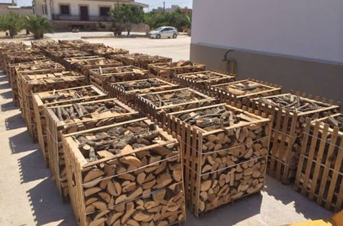 Sale of firewood in San Michele Salentino, Italy.