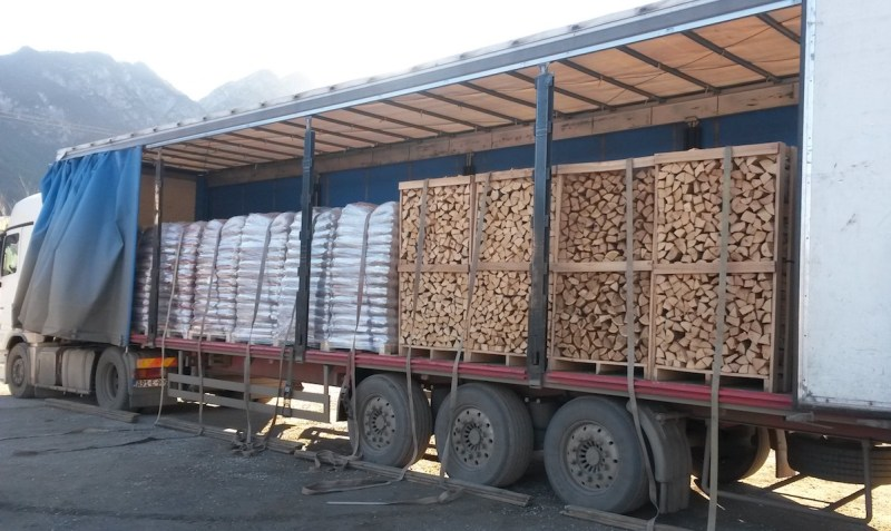 Firewood delivery curtain truck.