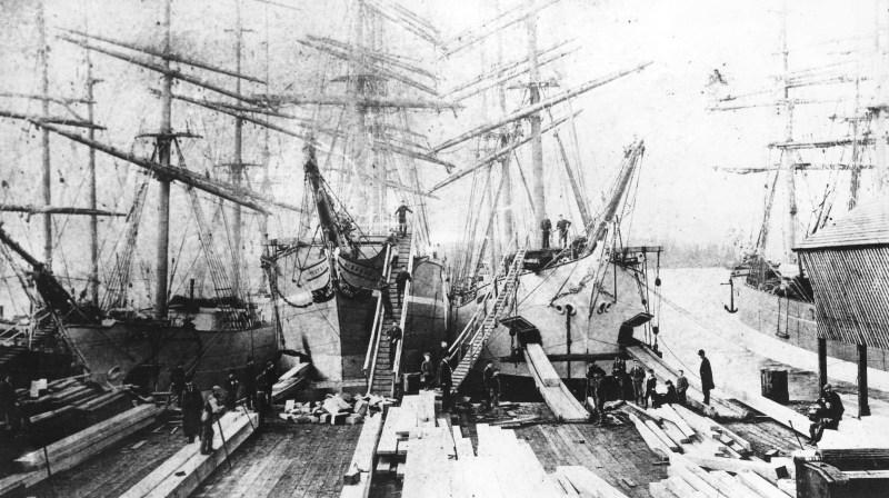 1890 Lumber ships loading at Hastings Sawmill.