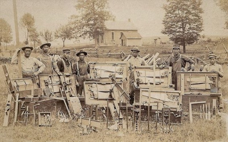 Carpenters and their tool chests.