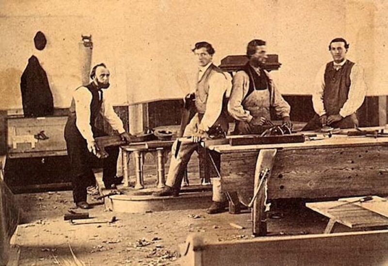 Carpenters in their workshop.