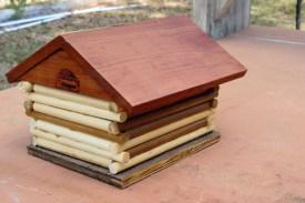 Log cabin style birdhouse